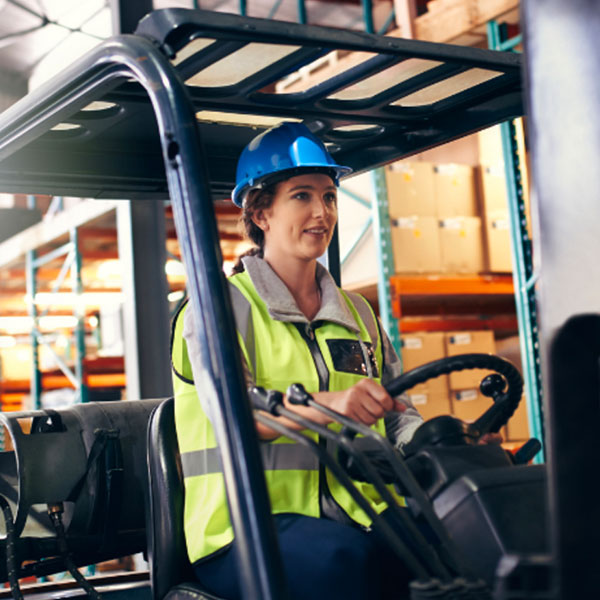 Woman driving a fork lift